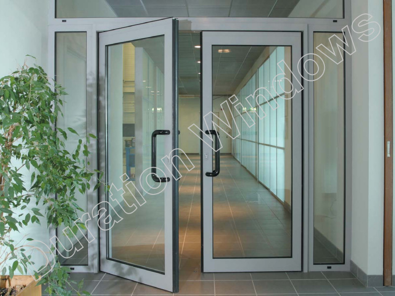 Shop doors and commercial entrances for high traffic use for Commercial entry doors